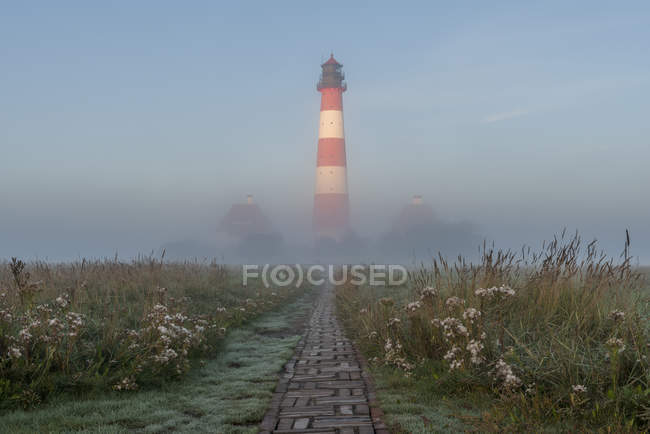 View of Westerheversand Lighthouse in the fog, Schleswig-Holstein, Germany — Stock Photo