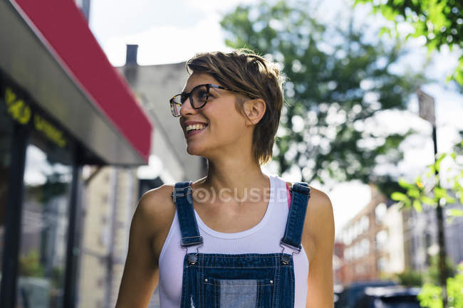 Smiling blond woman wearing spectacles — Stock Photo