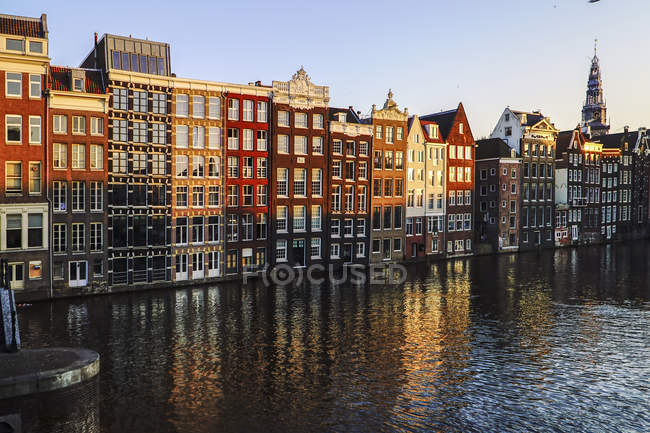 Netherlands, Amsterdam, Damrak, view to row of canal houses in the old town — Stock Photo