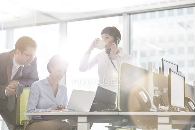 Three colleagues working in office together — Stock Photo