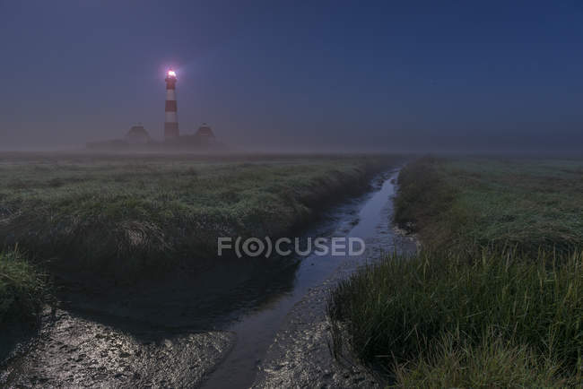View of Westerheversand Lighthouse at night, North Frisia, Schleswig-Holstein, Germany — Stock Photo