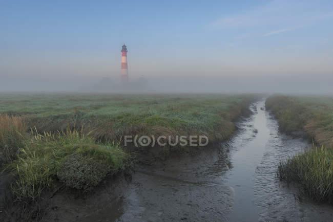 Germany, Schleswig-Holstein, North Sea Coast, View of Westerheversand Lighthouse, fog — Stock Photo