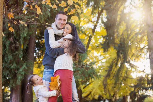 Happy family in autumnal park — Stock Photo