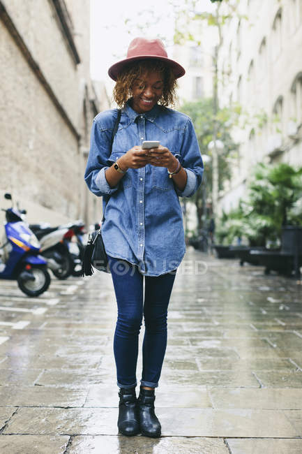 Woman using smartphone on street — Stock Photo