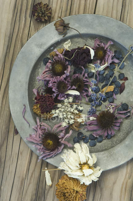 Top view of tin plate with dried flowers and berries — Stock Photo
