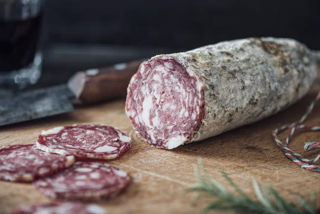 Close up of Sliced salami on cutting board — Stock Photo