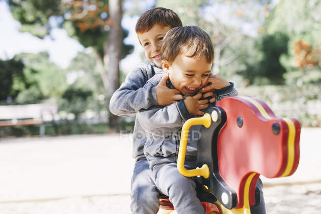 Two happy boys playing at the playground — Stock Photo