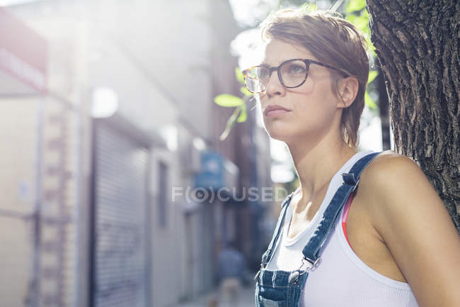 Portrait of woman at backlight wearing spectacles — Stock Photo