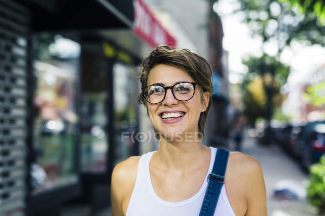 Portrait o happy blond woman wearing spectacles — Stock Photo