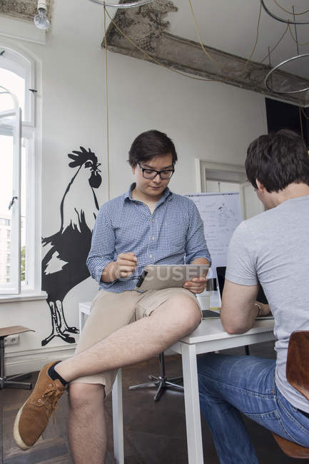 Two creative businessmen working in a modern office — Stock Photo