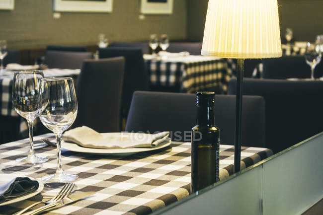 Laid tables in empty restaurant — Stock Photo