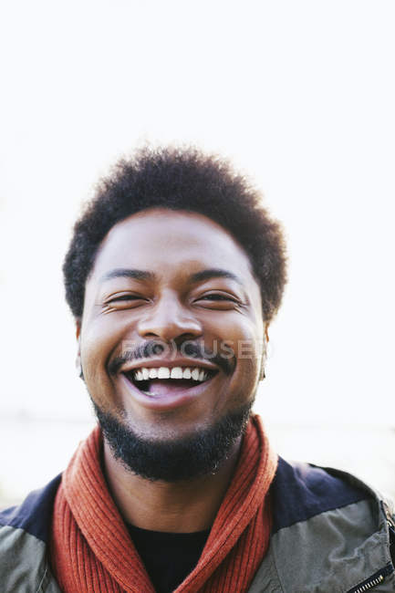 Portrait of laughing young man — Stock Photo