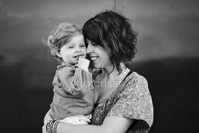 Tender moment between mother and toddler girl — Stock Photo
