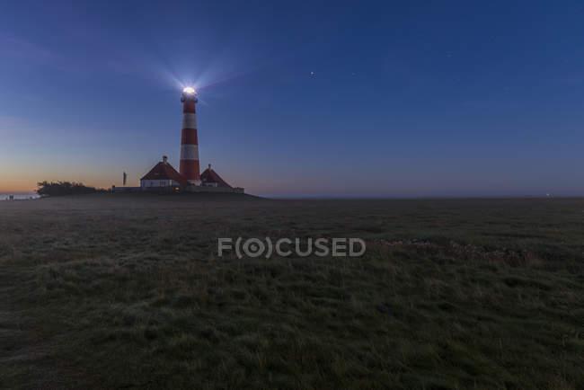 Germany, Schleswig-Holstein, North Sea Coast, View of Westerheversand Lighthouse at night — Stock Photo