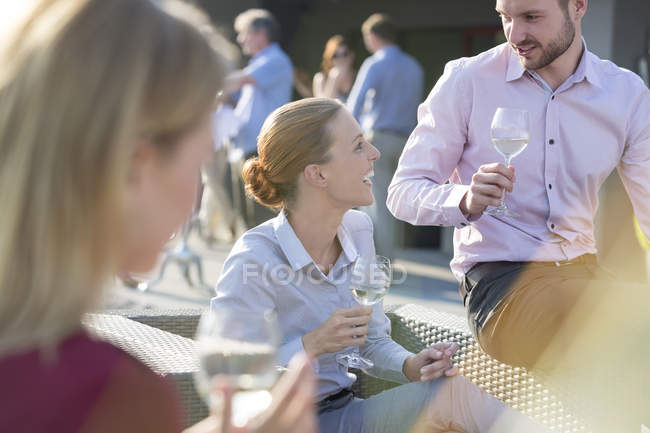 Colleagues socializing on company party outdoors — Stock Photo