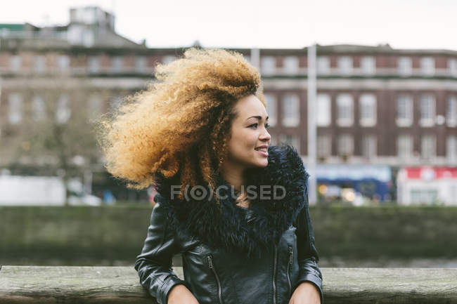 Smiling woman with afro hair looking aside — Stock Photo