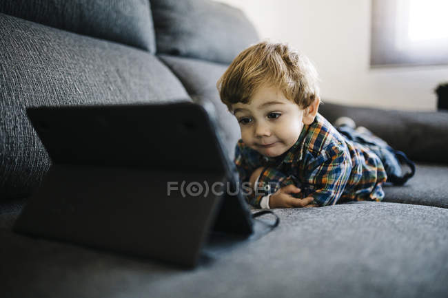 Little boy using digital tablet — Stock Photo