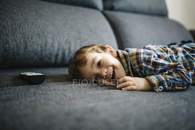 Little boy lying on couch — Stock Photo