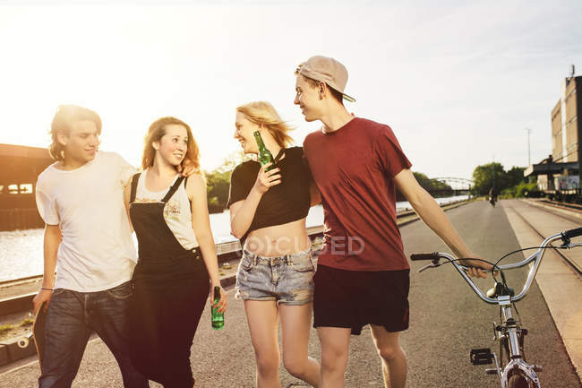 Friends hanging out together at the waterside — Stock Photo