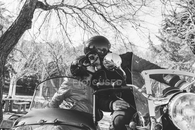 Mature couple kissing on sidecar motorbike — Stock Photo
