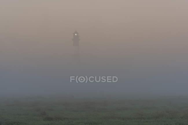 Westerheversand Lighthouse in fog — Stock Photo