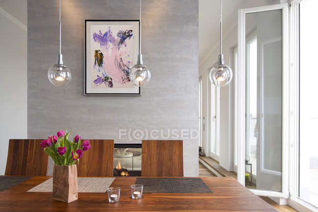 Interior of modern flat, Dining area and fireplace — Stock Photo