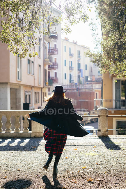 Italy, Verona, vital young woman running  in the city — Stock Photo