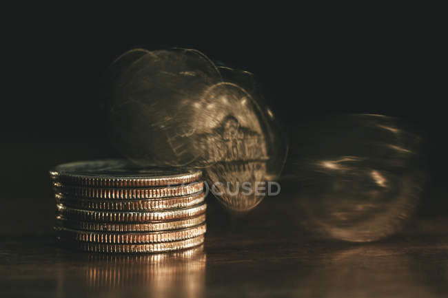 Coins falling from stack of coins — Stock Photo