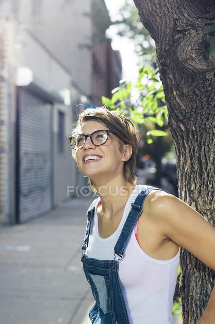 Portrait of happy blond woman wearing spectacles — Stock Photo