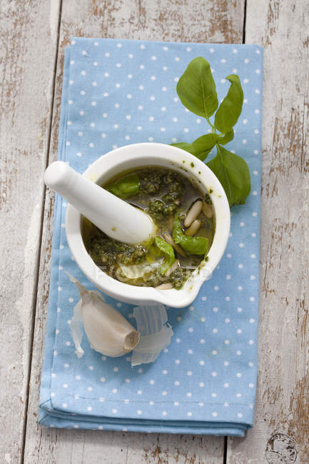 Mortar with ingredients of pesto — Stock Photo