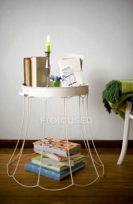Upcycled old lampshade used as side table — Stock Photo