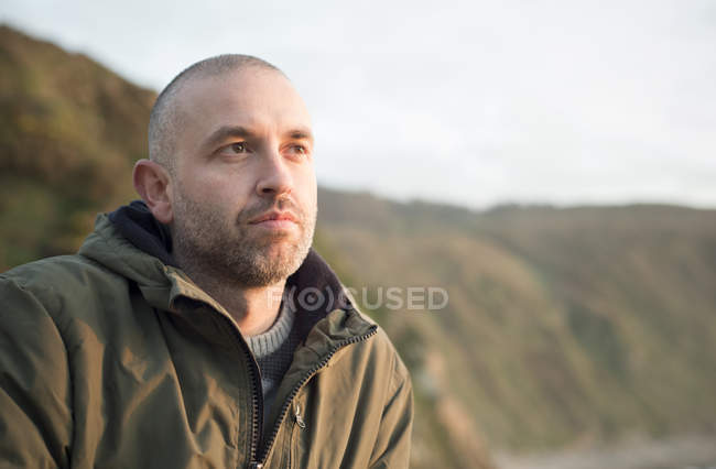 Portrait of man thinking outdoors — Stock Photo