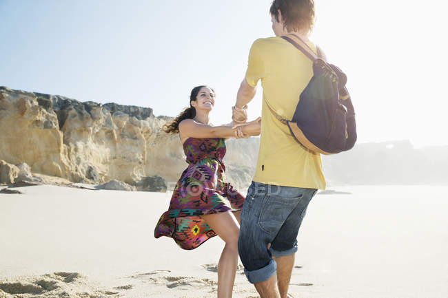 Couple having fun on beach — Stock Photo