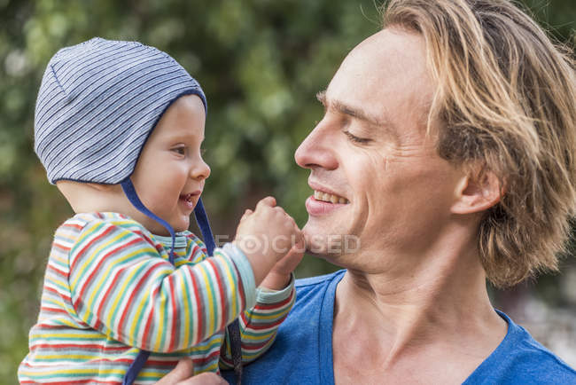 Man watching his little son — Stock Photo
