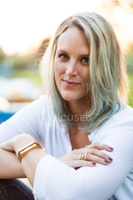 Portrait of blond woman with green coloured strand of hair — Stock Photo