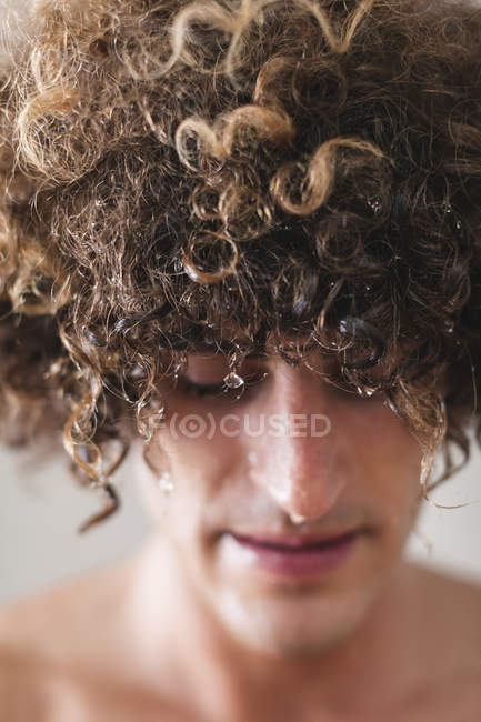 Man with wet curly hair — Stock Photo