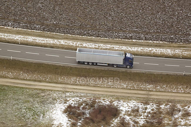 Southern Germany, aerial view of truck on country road — Stock Photo