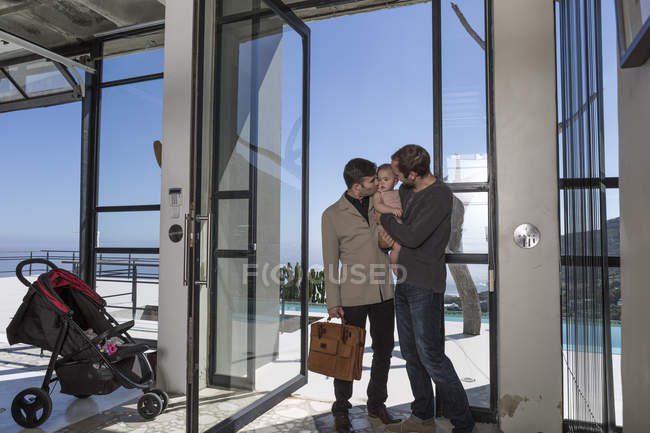 Gay couple and kid greeting each other — Stock Photo