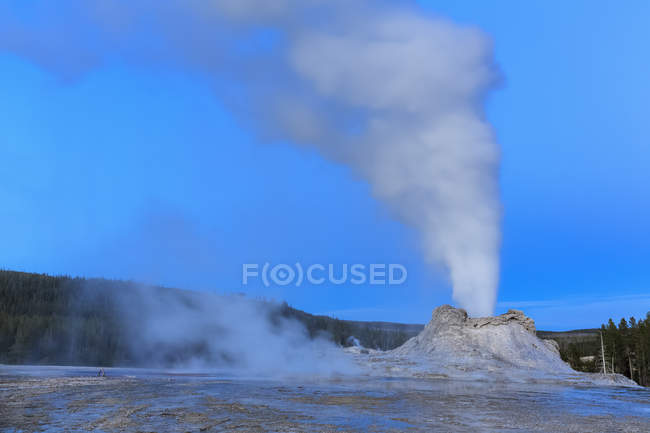 USA, Wyoming, Yellowstone National Park, Upper Geyser Basin, Castle Geyser erupting, blue hour — Stock Photo