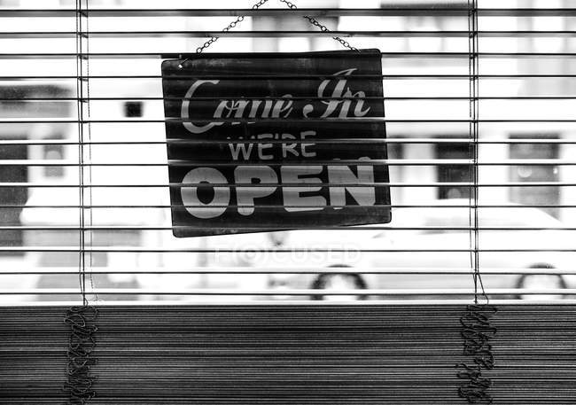 Back side of a closed sign hanging in a shop — Stock Photo