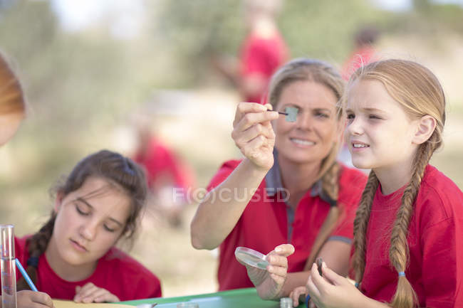 Kids and woman exploring nature with scientific equipment — Stock Photo