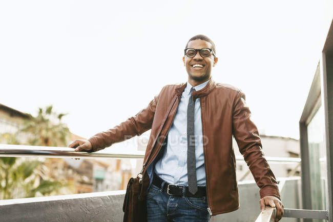 Laughing businessman wearing leather jacket — Stock Photo