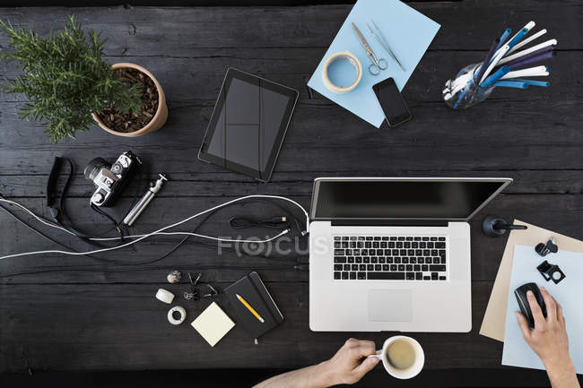 Man working at home office with laptop while drinking coffee — Stock Photo