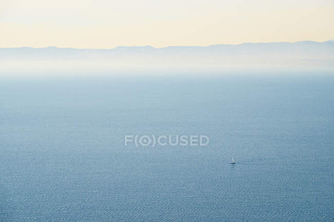 Sailboat and view from Rocca di Garda — Stock Photo