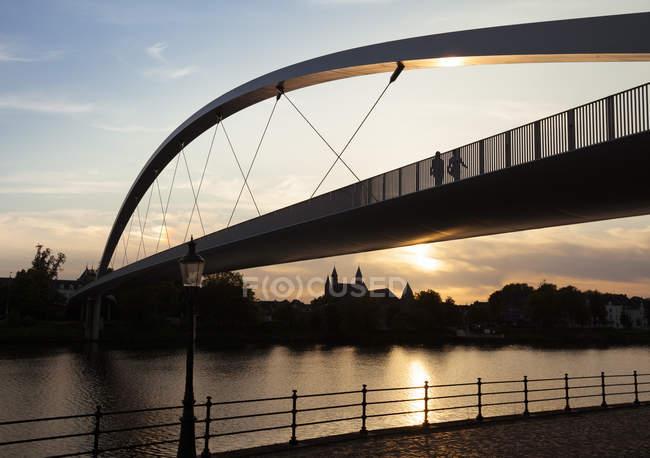 Netherlands, Maastricht, Meuse river and Hoge Brug at sunset — Stock Photo