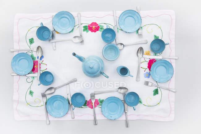 Antiguo esmalte azul claro muñeca china conjunto - foto de stock