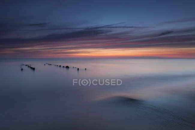 Germany, North Frisia, Sylt, Rantum, view to the sea by sunset, longtime exposure — Stock Photo