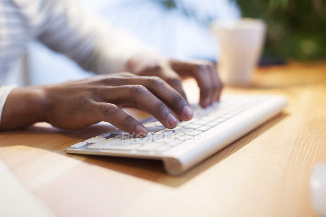 Male hands typing on keyboard — Stock Photo