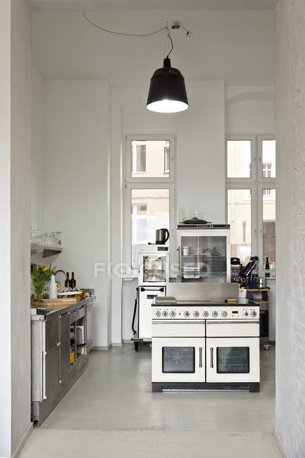 Bright interior of modern kitchen in bistro — Stock Photo