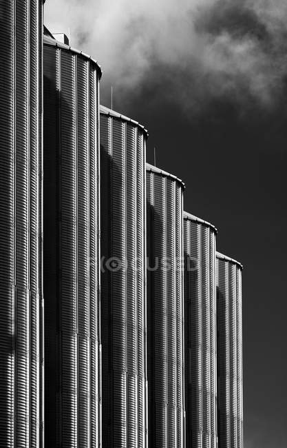 Germany, Grevenbroich, silos ana row, black and white — Stock Photo